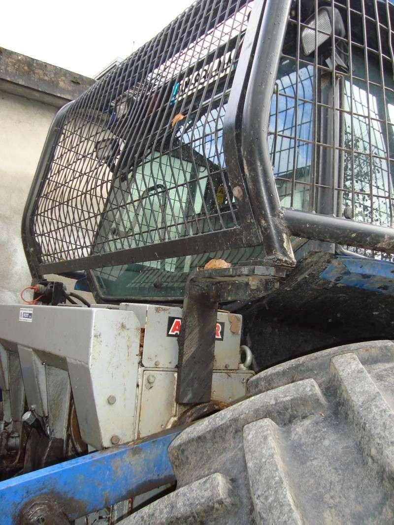 tracteur forestier New Holland TM155 Dsc08321