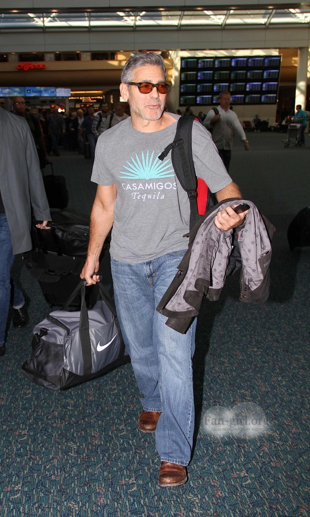 Photos: George Clooney arriving at  Orlando Airport  George15