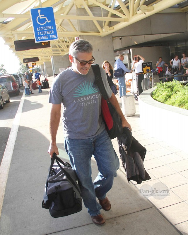 Photos: George Clooney arriving at  Orlando Airport  George18