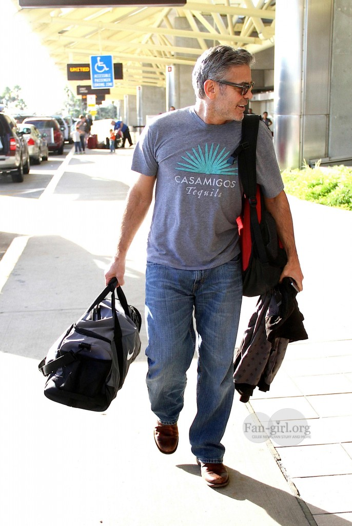 Photos: George Clooney arriving at  Orlando Airport  George20