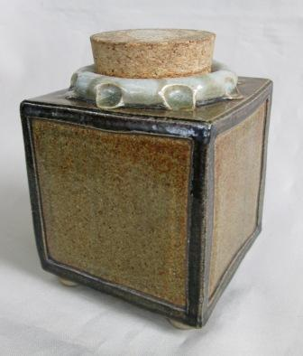 Cube with ball feet & cork is ade by Ian Webster Tea_ca11