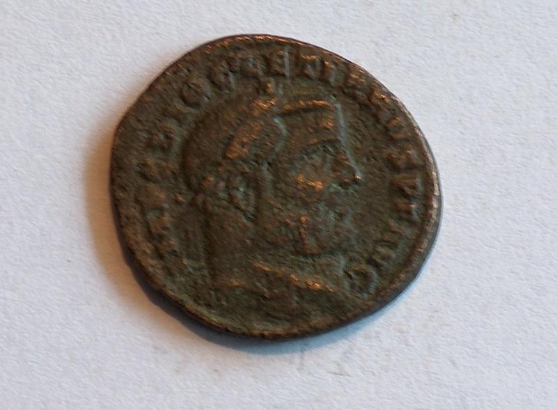 Identification romaine 7 Follis de Diocletien pour Ticinium 710