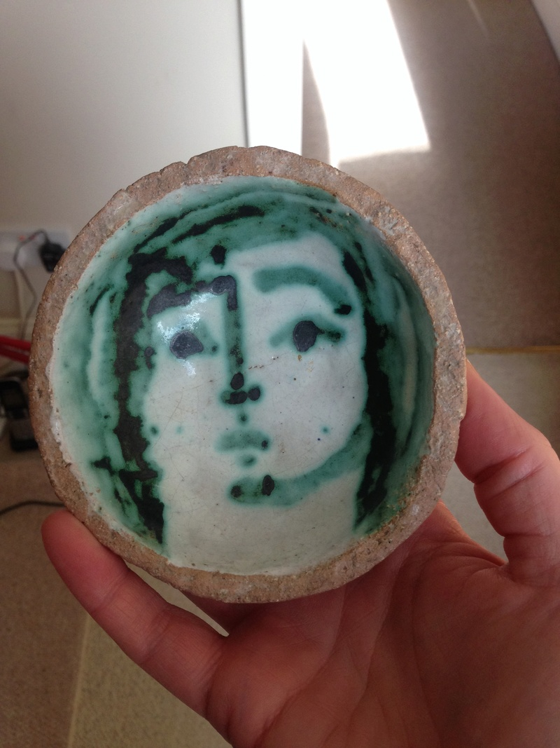 Coarse pottery bowl with painted face Img_1312