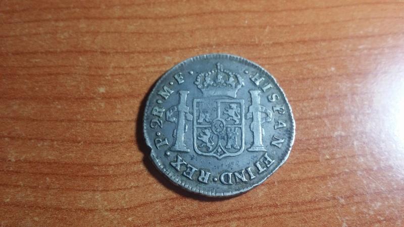 hola a ver que me podeis decir de esta moneda gracias. 211