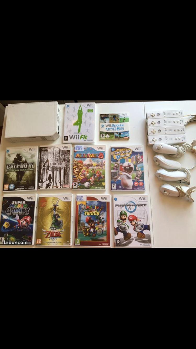 [VDS] Wii + 10 jeux (Mario, Zelda, Resident Evil...) + 4 Nunchuk + 4 WiiMote Img_2010
