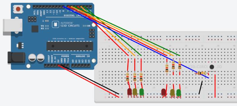 Come creare due semafori azionati da un pulsante (circuito e codice) con Arduino Arduin11