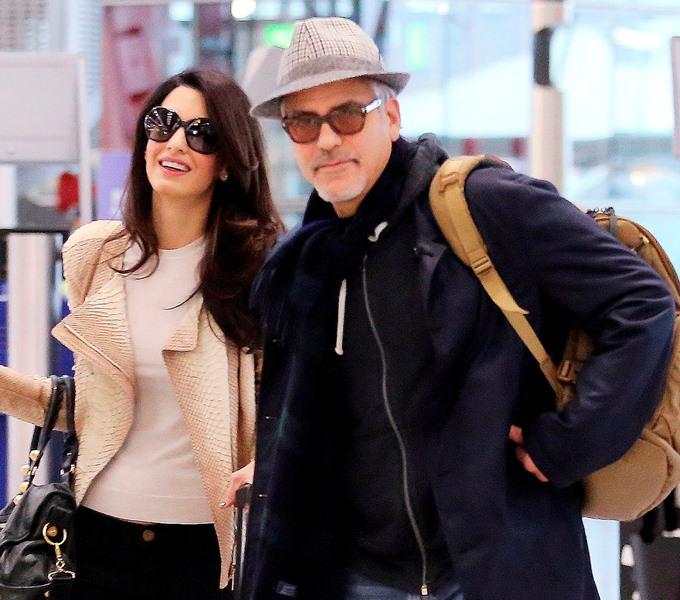 George and Amal Clooney spotted at Heathrow Ar10