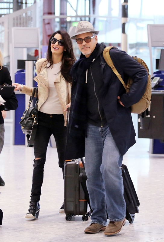 George and Amal Clooney spotted at Heathrow Ar210