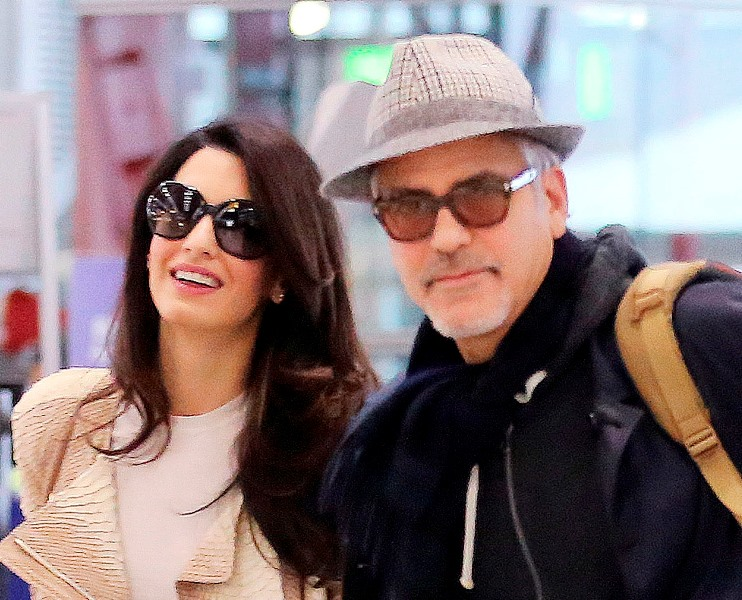 George and Amal Clooney spotted at Heathrow Ar310