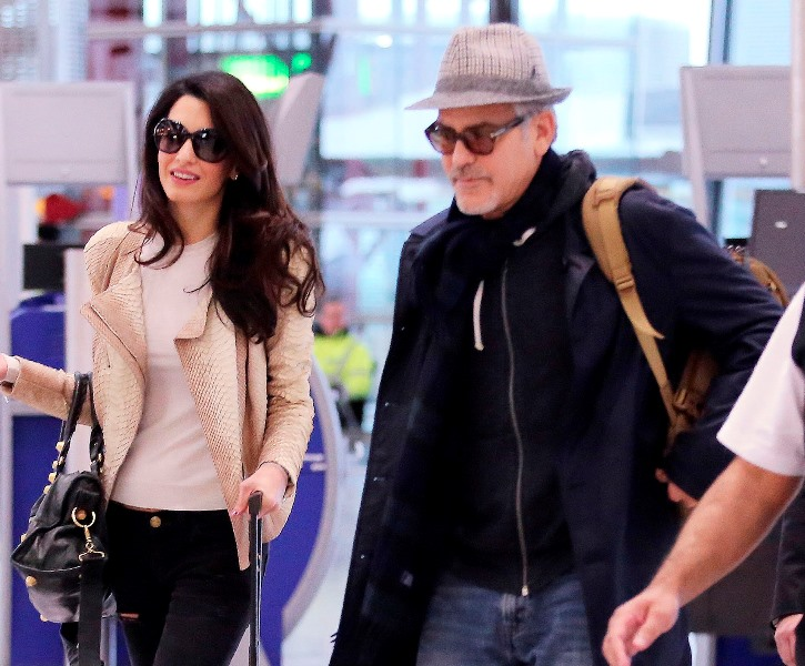 George and Amal Clooney spotted at Heathrow Ar410