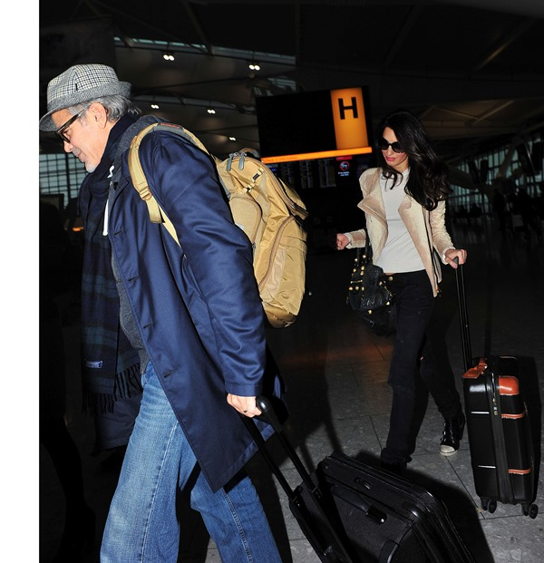 George and Amal Clooney spotted at Heathrow Ar510