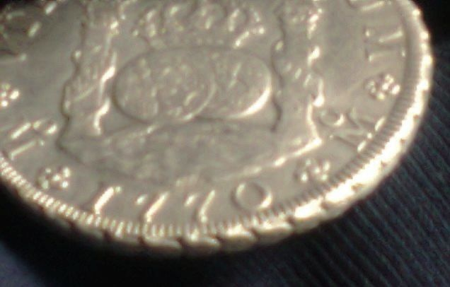 agains about 8 reales Dos Mundos 1770 , genuine or fake ? 00310