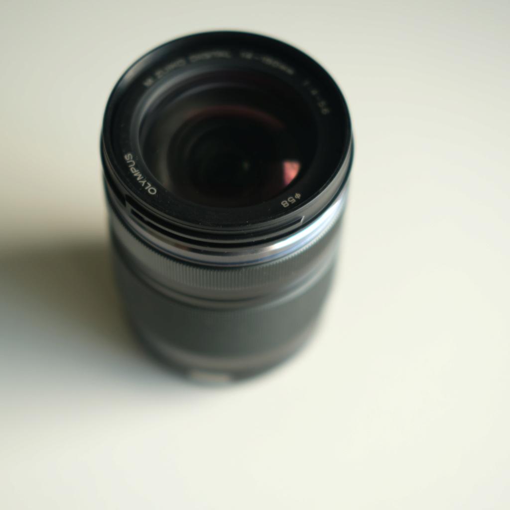[VENDU] Objectif OLYMPUS M.ZUIKO Digital ED 14-150mm F4-5.6 II Dscf1010