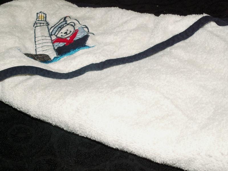 Capes de bain et gant de toilette dont neuf Pict0085