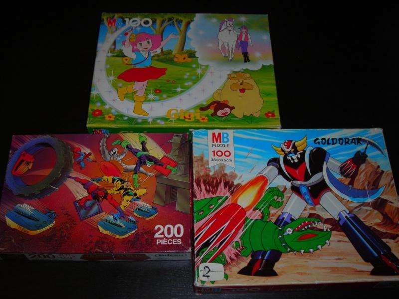 Les puzzles 80's de D.A, séries ou de  gamme de jouets.... Dscn5723