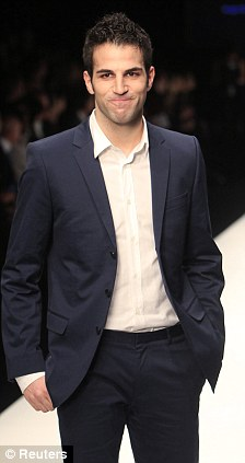 Captain Arsenal's Cesc Fabregas exhibitors in the fashion and model Articl11
