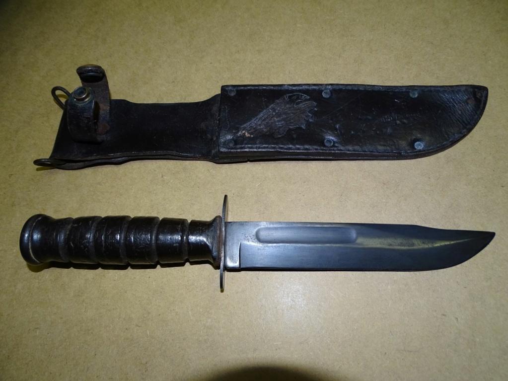 Origine de la tête d'aigle sur ce foureau cuir de couteau MK2 Dsc09014