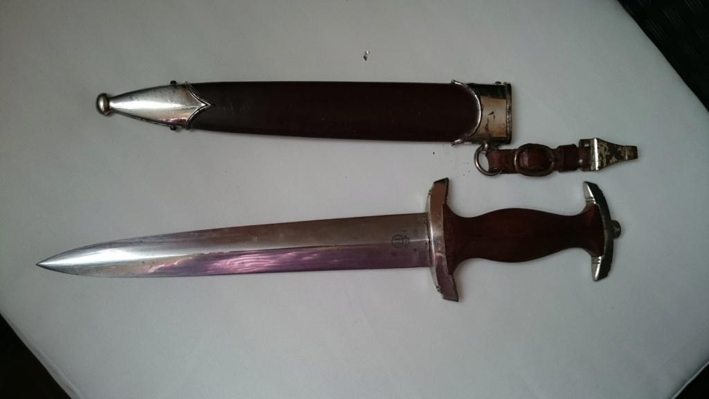 Une idée de la valeur de cette dague? Sony_117