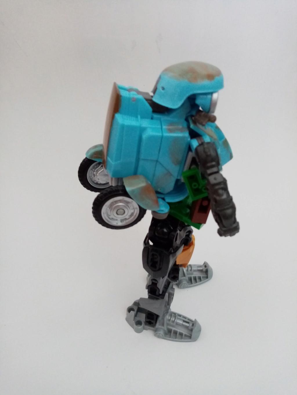 Vos montages photos Transformers ― Vos Batailles/Guerres | Humoristiques | Vos modes Stealth Force | etc - Page 16 Img_2049