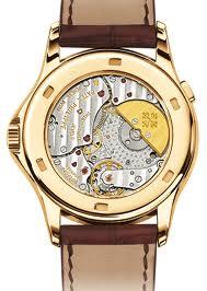 A qui appartient ce mouvement? quelle est le nom de la montre? Images13