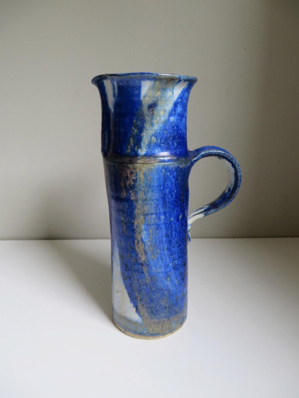 Tall jug with blue flambe like glaze - hand signed - hard to read! Img_0111