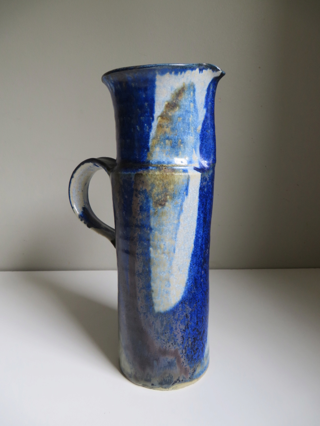 Tall jug with blue flambe like glaze - hand signed - hard to read! Img_0112