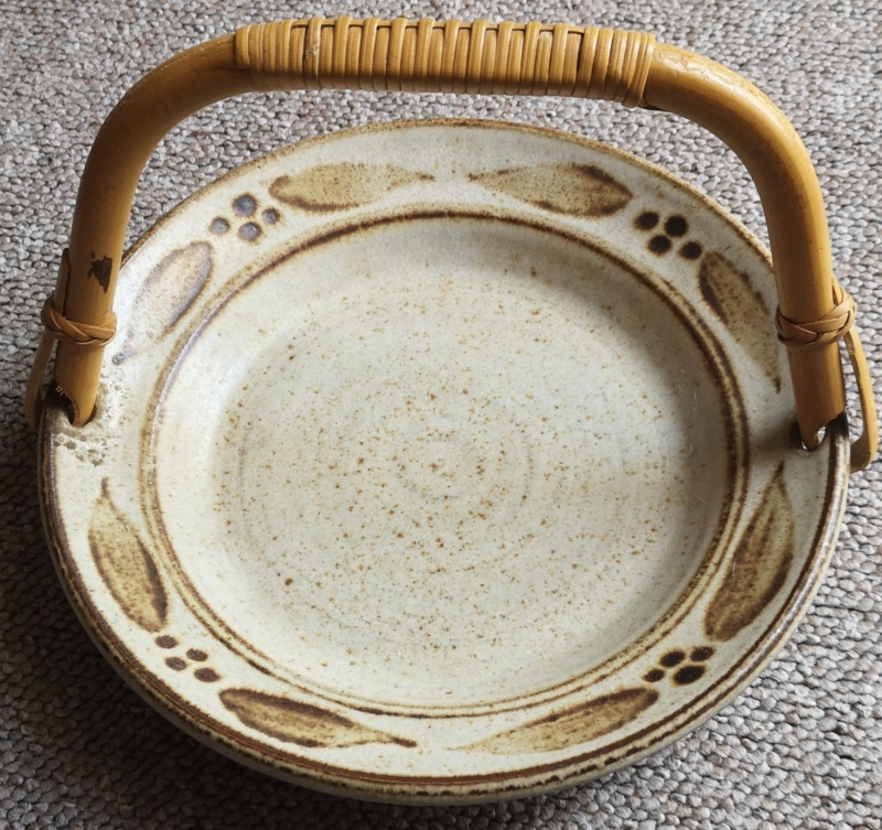 Unmarked dish with cane handle Img_2081
