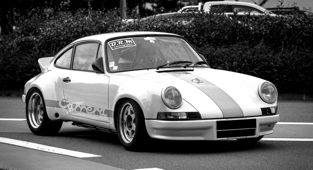 Une Belle photo de Porsche - Page 31 Slide_10
