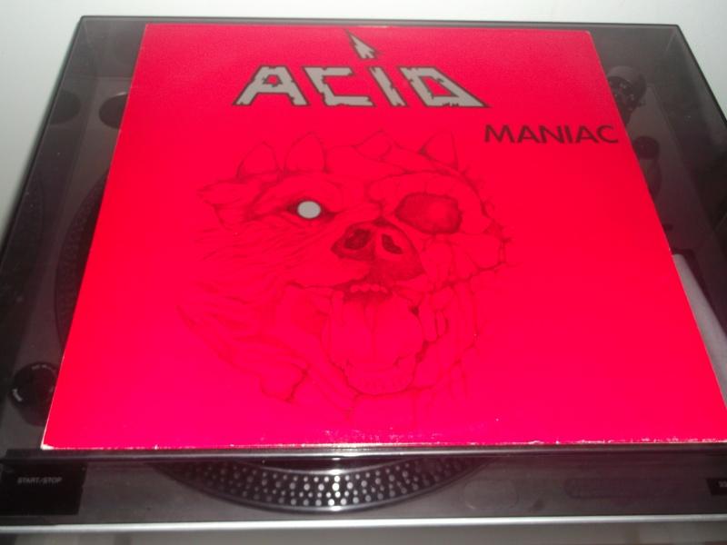 Etes vous du genre maniaque avec vos CDs , LP et autres? Acid_m12