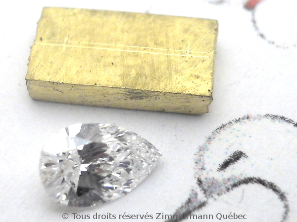 Un pendentif or 18 K avec un diamant poire de 33/100 ct D VVS1 Dscn3910