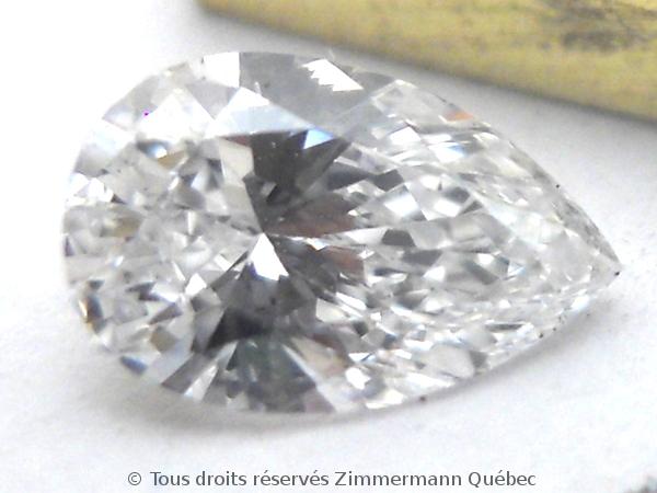Un pendentif or 18 K avec un diamant poire de 33/100 ct D VVS1 Dscn3911
