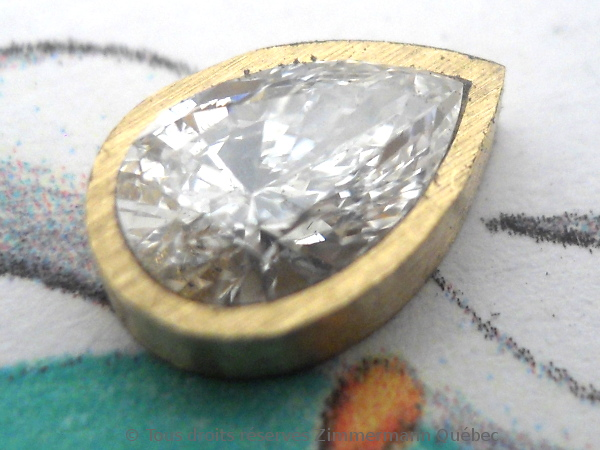 Un pendentif or 18 K avec un diamant poire de 33/100 ct D VVS1 Dscn3913