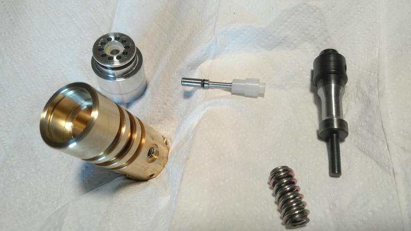 Essais pour diminuer la conso d'air sur une Buccaneer ? ressort valve marteau Img_2010