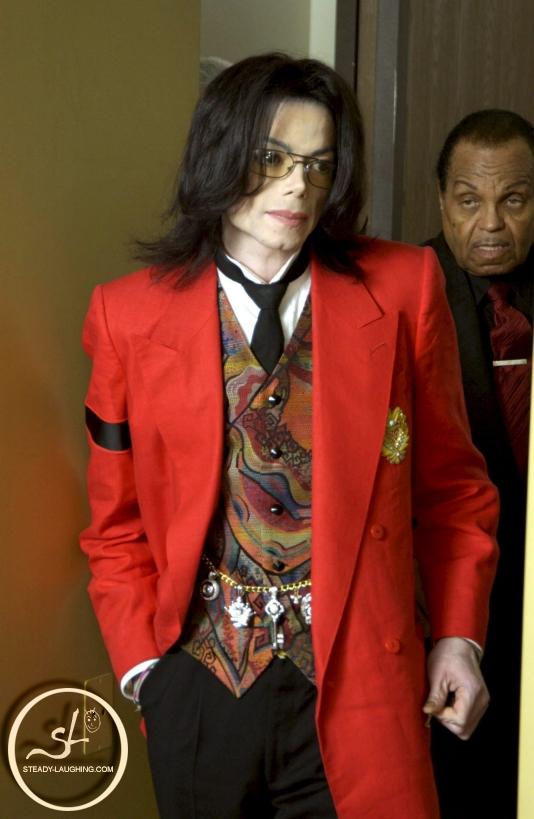Foto di Michael con abiti eleganti Giacca10