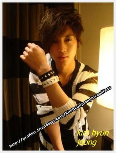 Kim Hyun Joong singing the official theme song for the Guangzhou 2010 Asian Games 1-744210