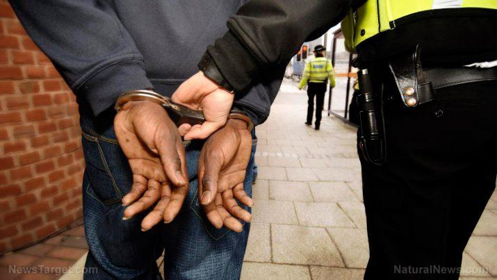 False Flag News - Fake hate crime busted: Police arrest black man for KKK graffiti at Michigan University Handcu10