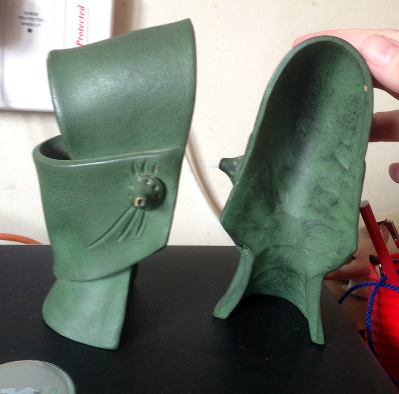 Unmarked pair of green faces; bookends  Img_8512