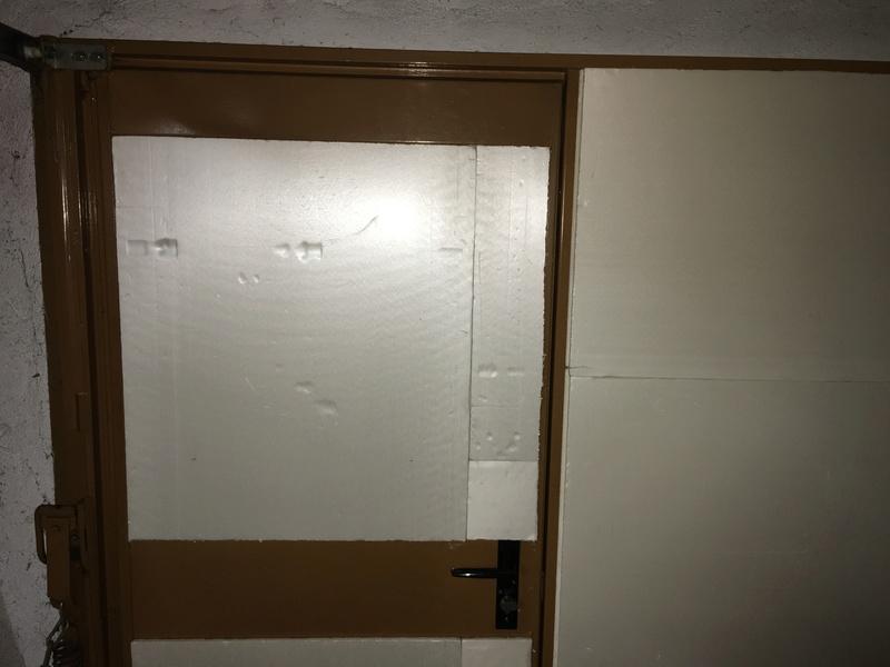 isolation porte de garage au sous-sol Ed97ec10