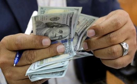 الدولار يواصل ارتفاعه و يقترب من حاجز الـ 18 جنية مرة اخرى 3722