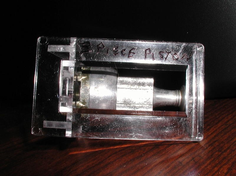 Finally, a Cox three piece piston........... Cox_3_10