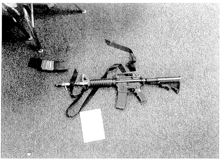 Photo's of mass murderer's weapons Busmas10