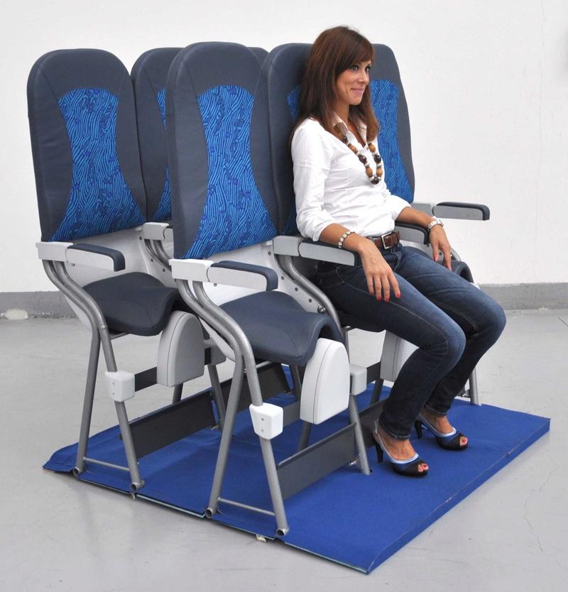 Y hablando de ideas de mierda... (nuevos asientos verticales para clase turista) Asient12