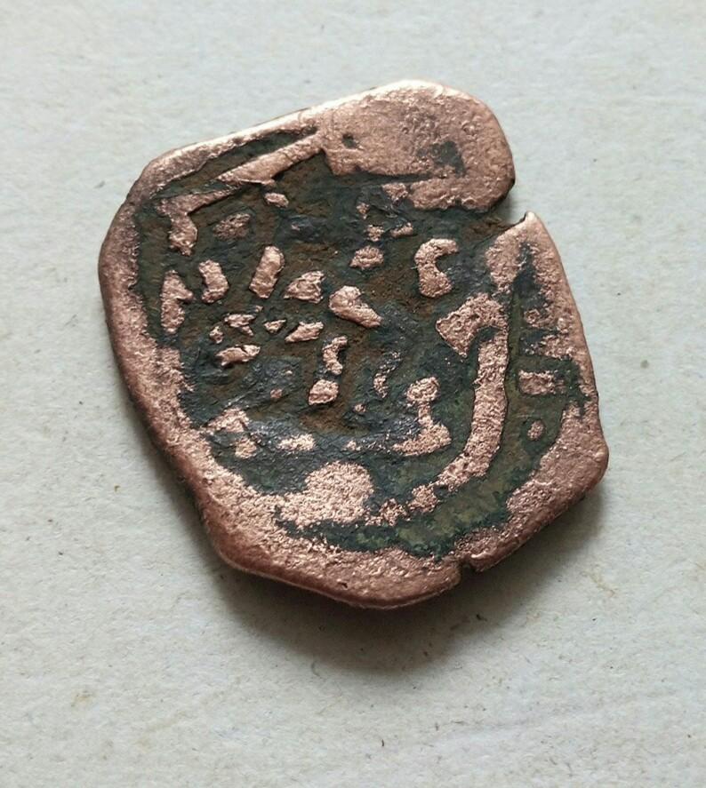 moneda a identificar,  11f89810