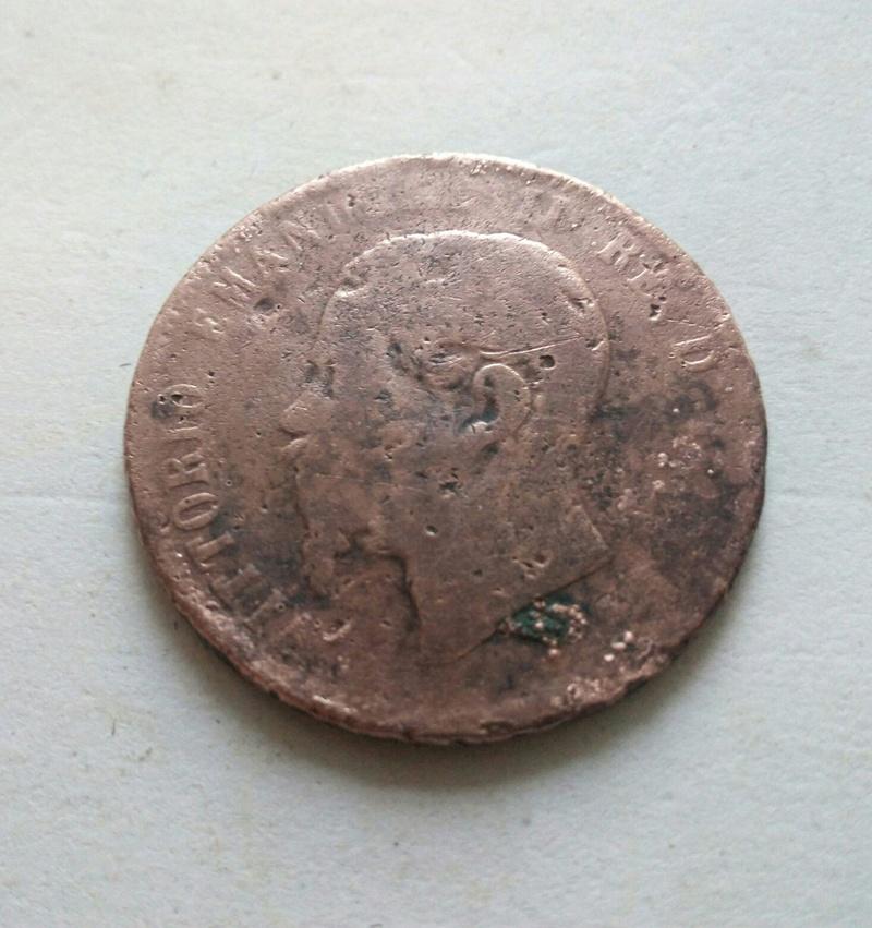 de quien puede ser  esta moneda ?? 4c35cf10