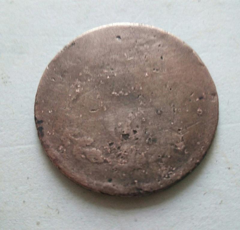 de quien puede ser  esta moneda ?? Dd532110