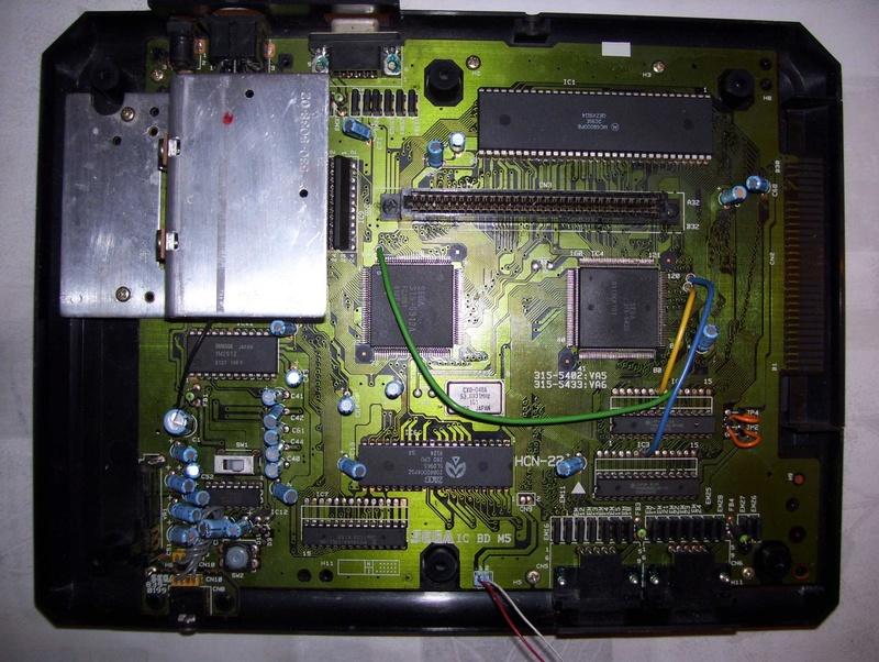 Réparer une Mega Drive Jap switchée en 50Hz (Jumpers perçés) Dumq5610