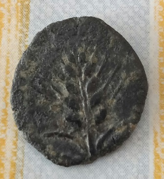 Cuadrante de Ituci . Pez , luna y espiga . 585