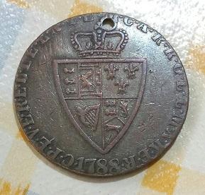 Jorge III, demi guinée cuivre avec trou, 1788. 5a91