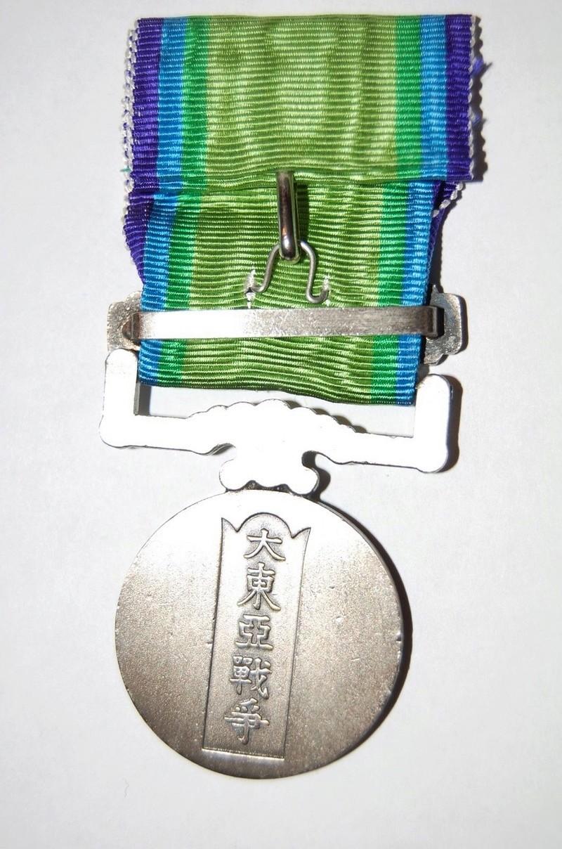 La médaille de guerre du grand est asiatique 大 東 亜 戦 争 ..et ses variantes Grand_11