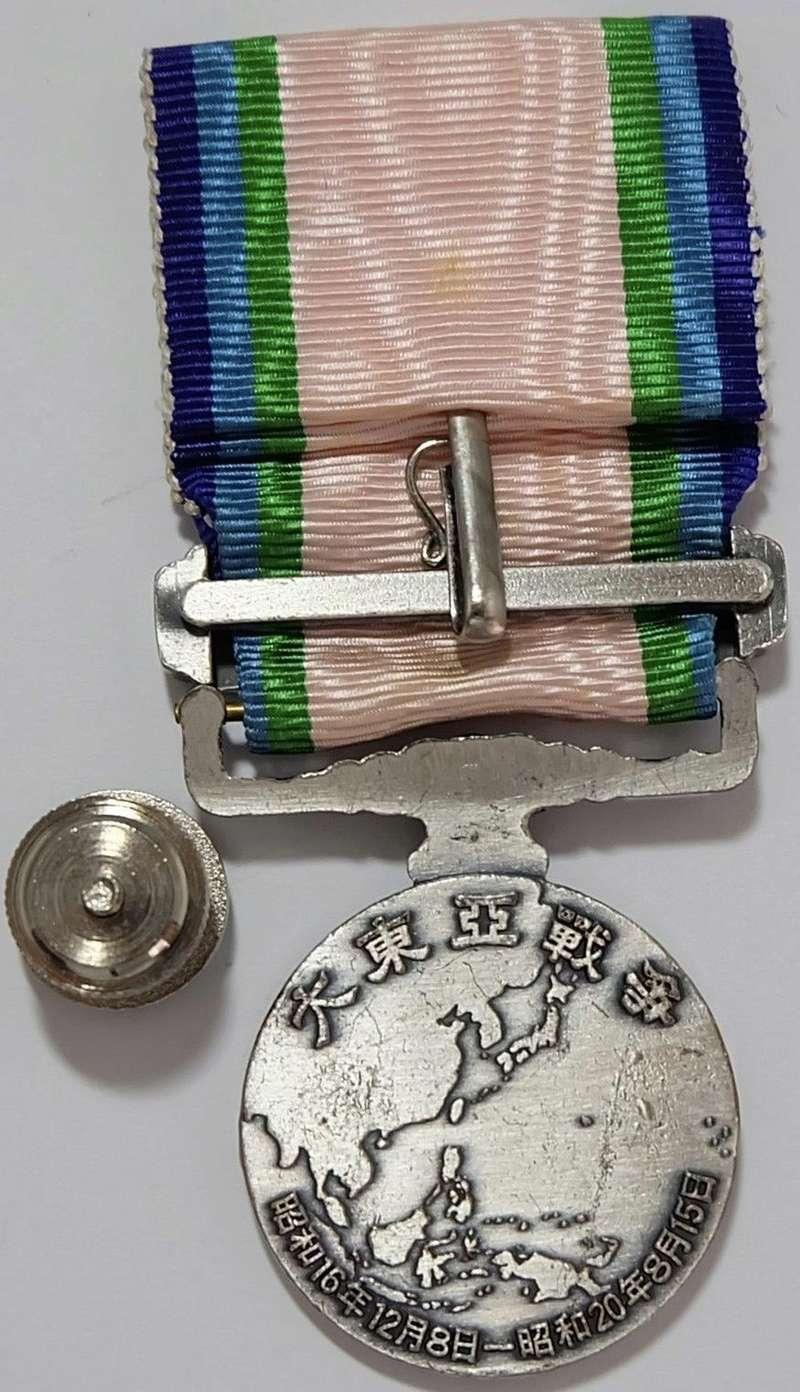 La médaille de guerre du grand est asiatique 大 東 亜 戦 争 ..et ses variantes Grand_18